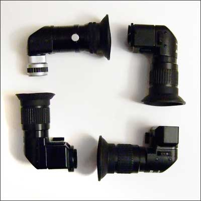 Clockwise from the lower-left: Minolta Angle Finder VN with Kirk FA-1 adapter, Nikon DR-4 with DK-12 adapter, Nikon DR-5, and Nikon DR-6